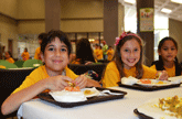 Photos of kids eating lunch to represent Free and Reduced Meal Prices Guidelines