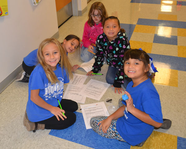 Second graders work on a science project at Las Animas Elementary School, which is led by a principal who is a strong believer in Colorado state standards.