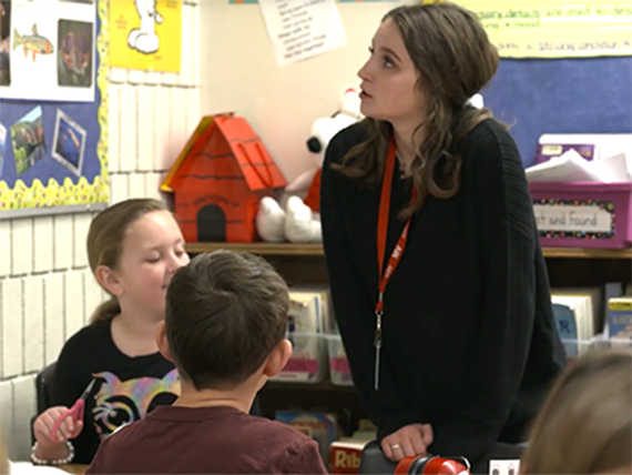Teacher and students in a classroom at Littleton Public Schools